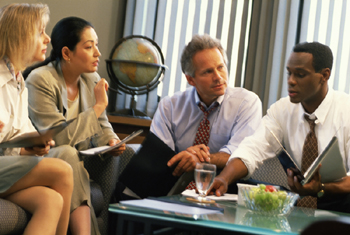 business professionals in meeting around a coffee table
